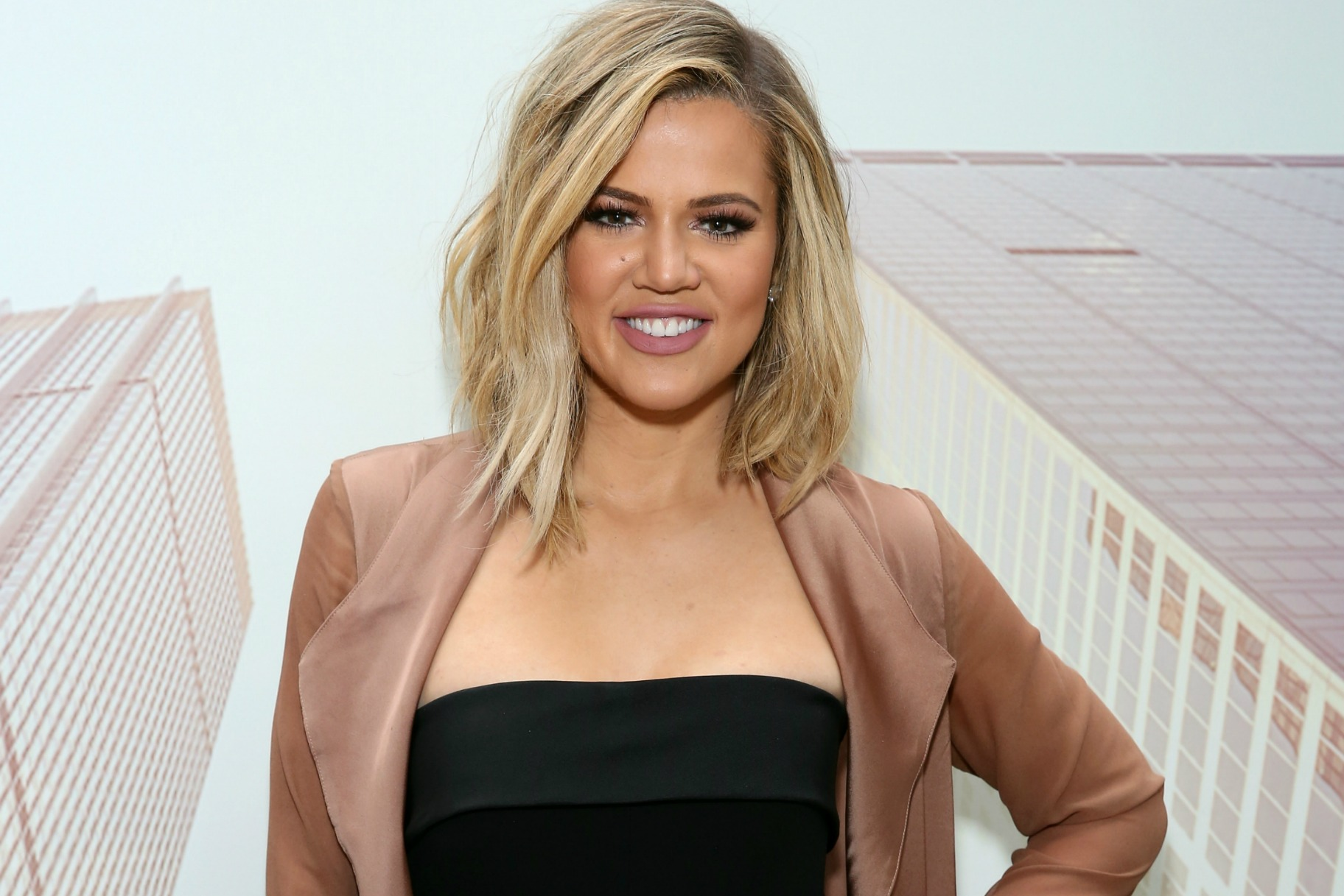Khloe Kardashian Finally Shows Off Baby Bump